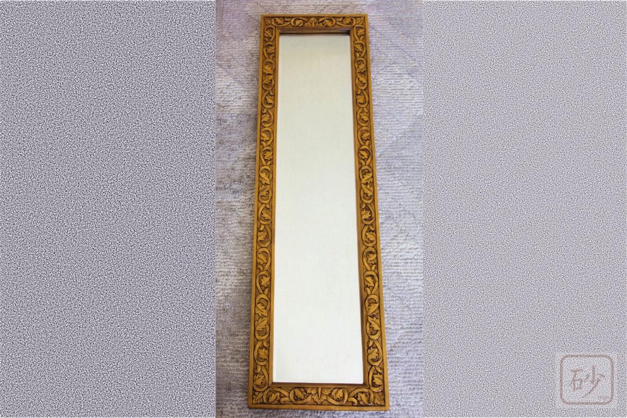 木彫りの長鏡
