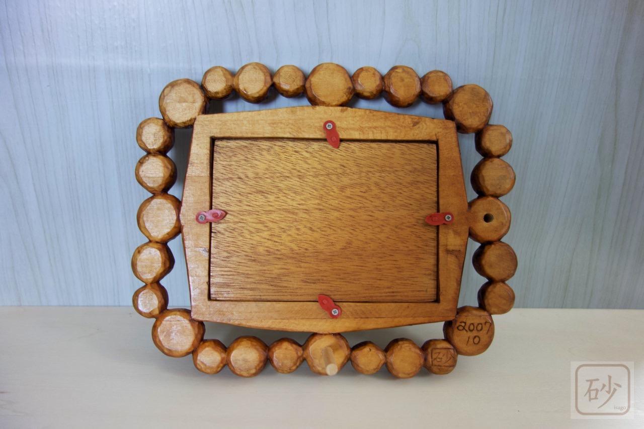 木彫りの写真立て
